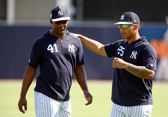 New York Yankees third baseman Miguel Andujar (41) and second baseman Gleyber Torres (25) talk on the field during spring training workouts at George M. Steinbrenner Field.