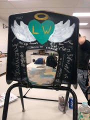 Boonton High School students memorial messages on the chair of junior Luke Warbeck, killed on Route 23 with his father Jon and Delta gas station attendant Lovedeep Fatra on Feb. 19.