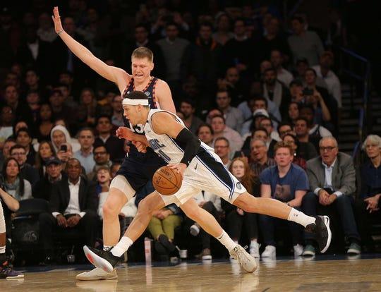 Orlando Magic forward Aaron Gordon (00) dribbles against New York Knicks forward Henry Ellenson (13) during the second half at Madison Square Garden.
