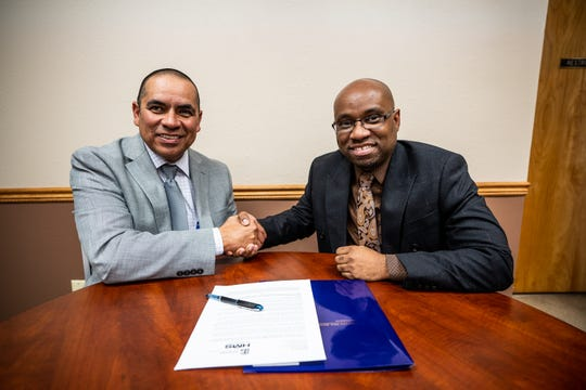Western New Mexico University Vice President of Student Affairs Dr. Isaac Brundage and Hidalgo Medical Services CEO Dan Otero sign an agreement to offer student health services at HMS sites.