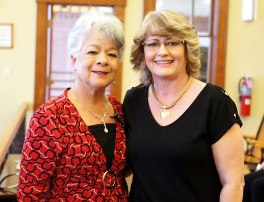 "Administrative assistant Kristi Hobbs, right, was presented with a 10-year service pin during a recent Luna County Board of Commissioners' meeting at the historic Luna County Courthouse. Hobbs has served as an administrative assistant for Luna County Treasurer Gloria Rodriguez (left). ""Kristi has been my right hand in the Treasurer's Office,"" Rodriguez said."