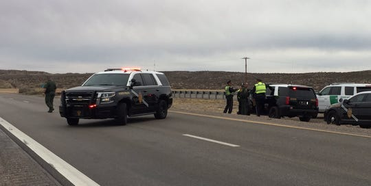 New Mexico State Police and other agencies on Feb. 27, 2019 investigate following an officer-involved shooting along Interstate 25 north of Las Cruces.
