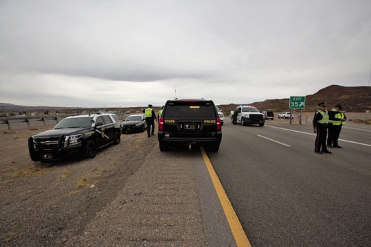 "New Mexico State Police blocks off mile marker 35 near Rincon while investigating an officer-involved shooting. State Police say an officer shot a suspect who was holding a 7-year-old ""hostage"" in a vehicle parked along Interstate 25 on Wednesday, Feb. 27."