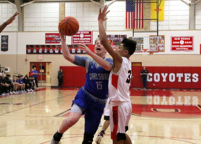 Andrew Miller goes for a contested layup in the first quarter of Tuesday's game against Roswell. Miller scored four points, all in the first quarter.