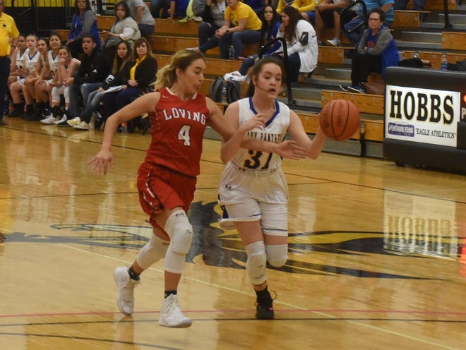 Chasity Onsurez reaches for the ball before stealing it from Jal's Natalie Nunez (31) during the second quarter of the Lady Falcons 42-35 win over Jal. Onsurez had  11 rebounds, 8 steals, and 6 points for the Lady Falcons.