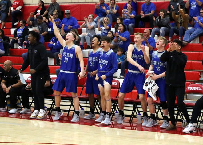 Carlsbad's bench erupts after Matt Hernandez made his second 3-point shot in the fourth quarter of Tuesday's Class 4-5A tournament game against Roswell. Fernandez scored 11 points, all in the fourth quarter.