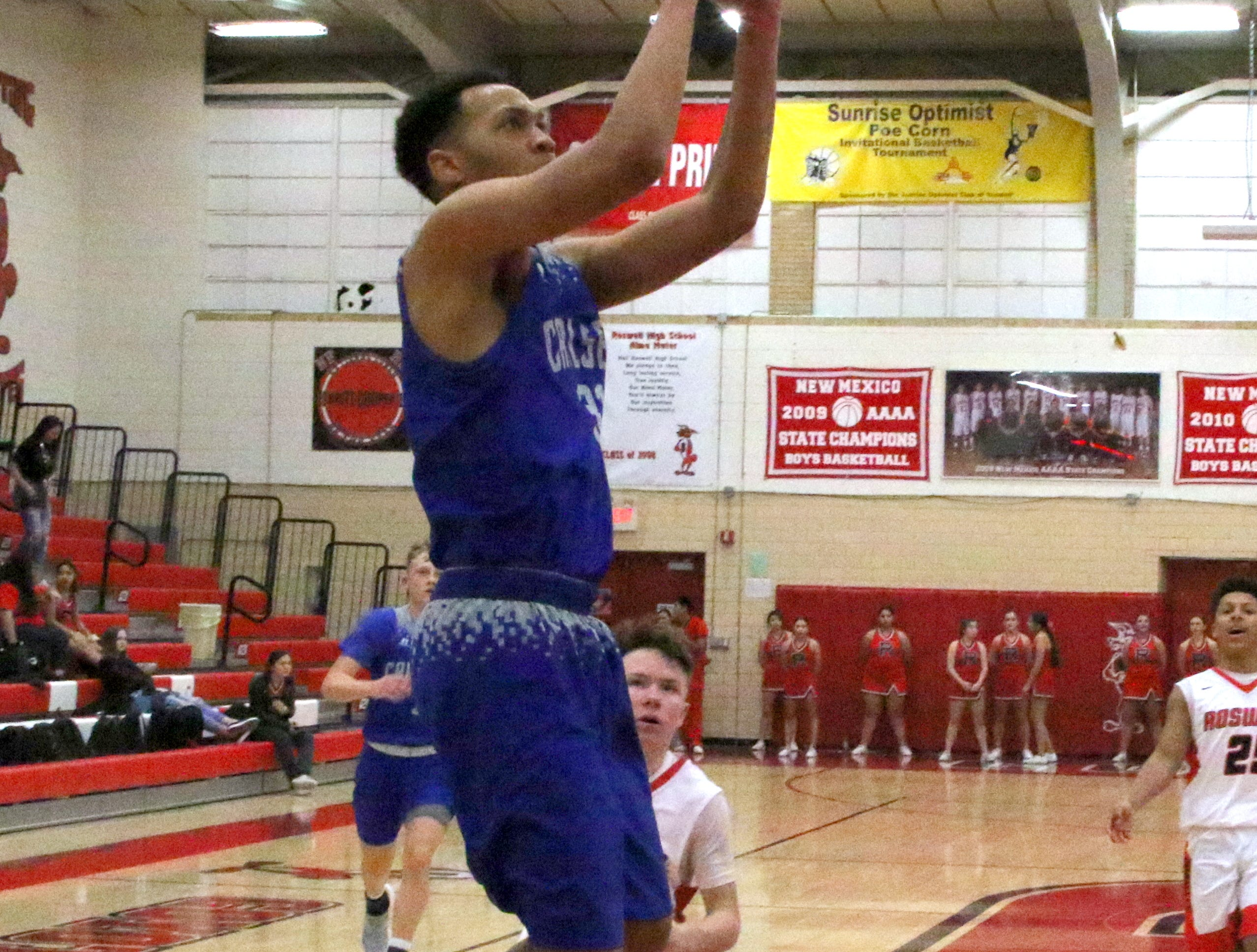 Phillip Lee gets an alley-oop layup off an assist from Josh Sillas in the fourth quarter of Tuesday's Class 4-5A tournament game against Roswell. Carlsbad went on a 16-2 run to start out the final quarter.