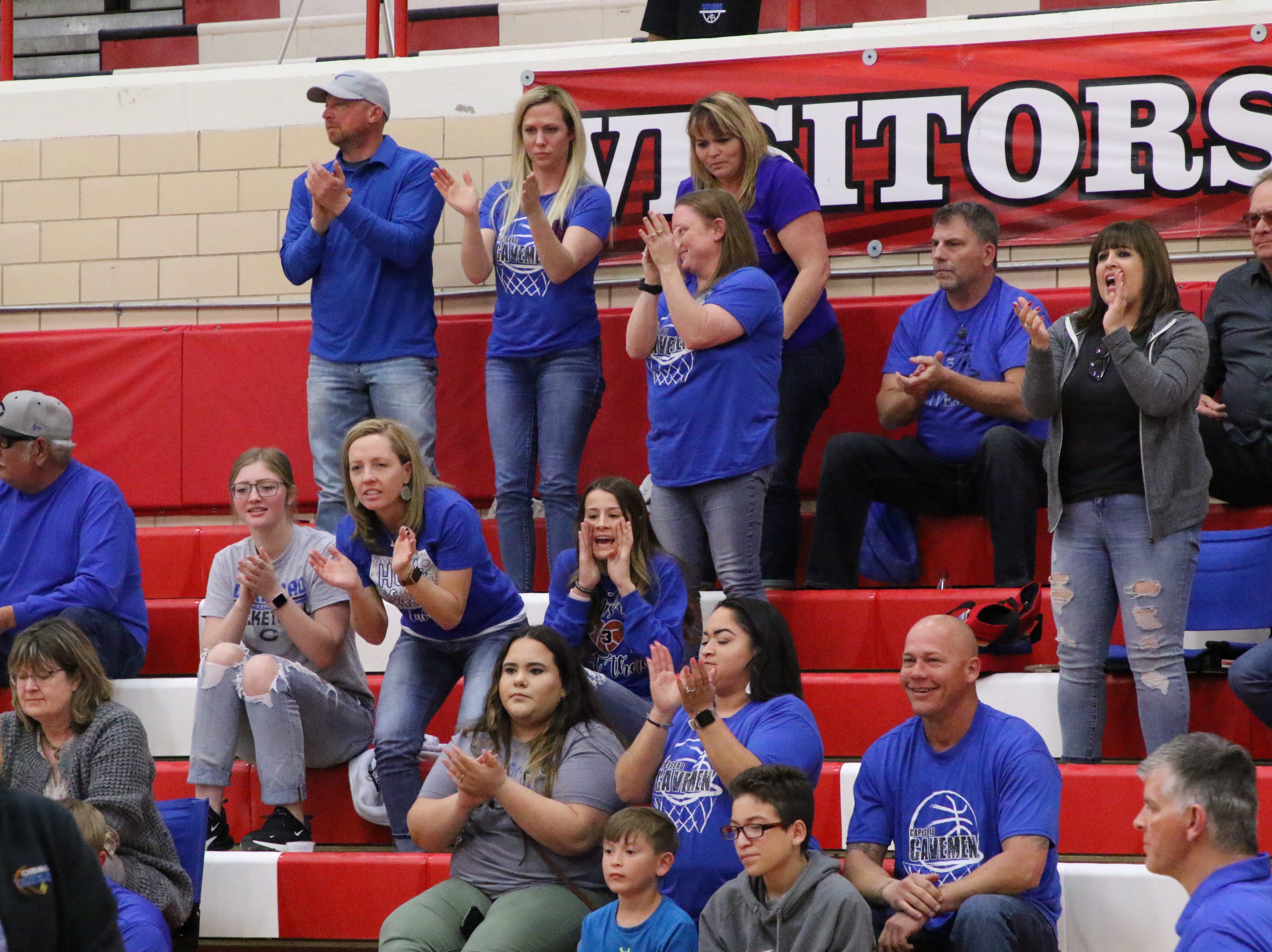 The Carlsbad faithful applaud the Cavemen's 16-2 run to start out the fourth quarter of Tuesday's Class 4-5A tournament game against Roswell. Carlsbad scored 27 points in the final quarter.
