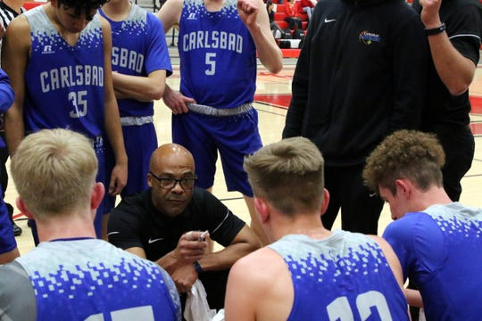 Carlsbad head coach Jamaal Brown talks to his players during a timeout in Tuesday's Class 4-5A playoff game against Roswell. Carlsbad won, 59-52.
