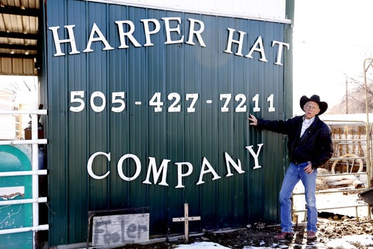 Ramie Harper stands beside his hat shop, Tuesday, Feb. 26, 2019, in Fruitland.