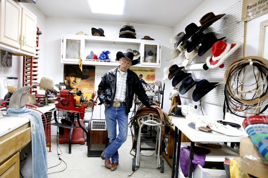 Ramie Harper stands in his hat shop, Tuesday, Feb. 26, 2019, in Fruitland. Harper has made a cowboy hat for President Donald Trump.