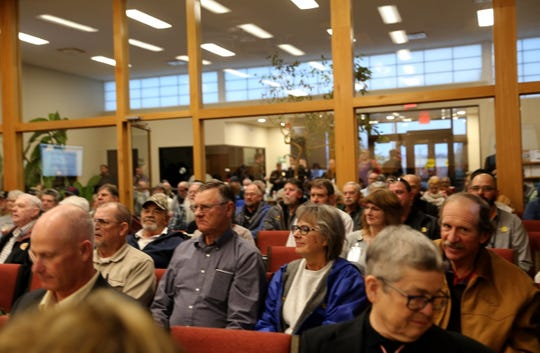 A crowd gathers, Tuesday, Feb. 26, 2019, in the Farmington City Council chambers as the council discussed a Second Amendment Preservation City resolution.