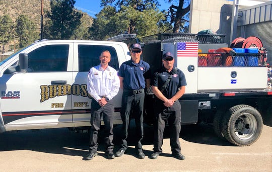 Ruidoso Fire Chief Cody Thetford,  left, firefighter Quade Hall, and Capt. Jared Wilson stand in front of Engine 14, the latest addition to the RFD fleet of fire trucks.