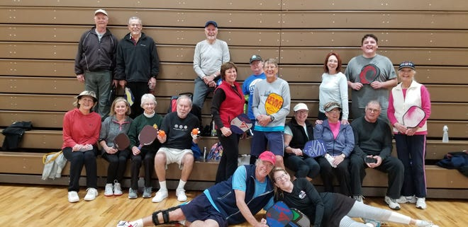Pickleball club members ham it up after playing at the Horton Gym in Ruidoso Feb. 21.