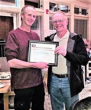 Rick Hall, Bonito Volunteer Fire Department Fire Chief, at right, presents a certificate to Assistant Chief Robby Hall for more than 20 years of volunteer service.