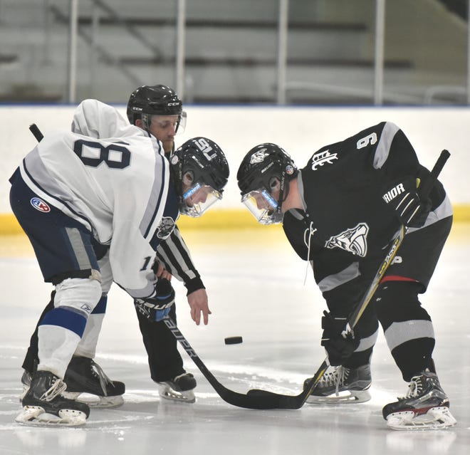 South Lyon United's Garrett Rutt, left, takes the faceoff against Plymouth's Ian Smith..