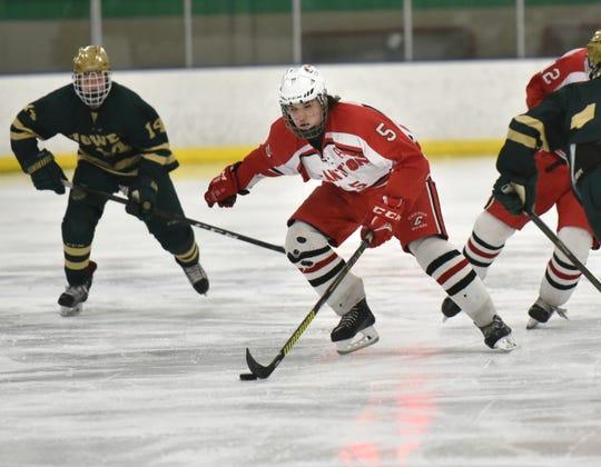 Chief Hugo Fonovic skates up ice against the Howell Highlanders on Feb. 26 in MHSAA regional hockey playoffs at Farmington Ice Arena.