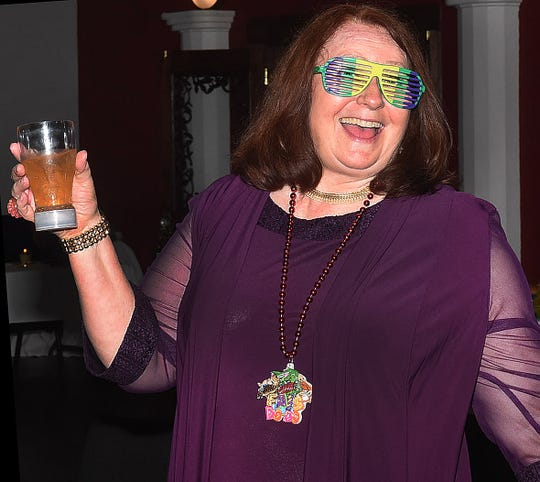 Passing a good time at the Imperial Mardi Gras Ball held Saturday at the Delta Grand Theater.