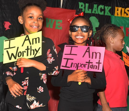 Washington Elementary students take part in the school's annual black history program held recently in the school gymnasium.