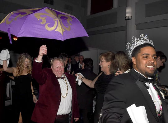 Imperial King Dustin Miller leads the line as they dance to the Mardi Gras Mambo at Saturday's Imperial Mardi Gras Ball.