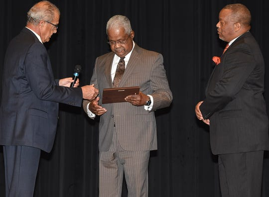 """Alvine . """"Chubby"""" Haynes was one of four citizens honored by the St. Landry Black History Committee.  Presenting his award were Pat Fontenot, left, and Jerry Red, Jr. who served as master of ceremonies."""
