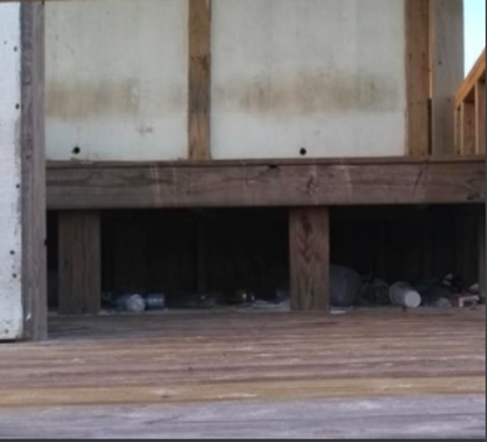 Trash is pictured under one of the lifeguard stations at Navarre Beach. Officials will replace the old wooden stations with new aluminum stations that are easier to move and not as easy to place trash under.