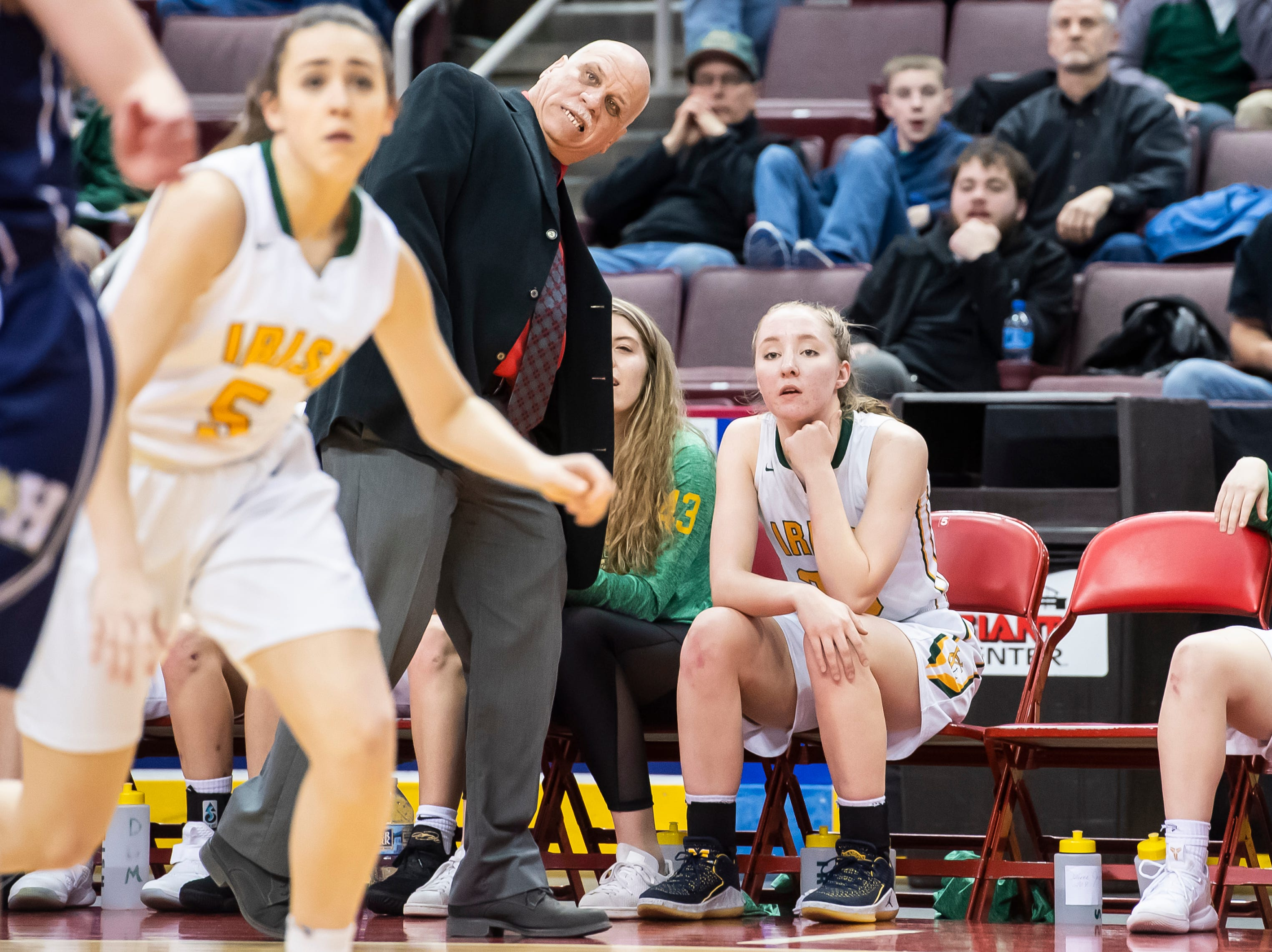 York Catholic head coach Kevin Bankos watches as the Fighting Irish take a 3-point attempt during the District 3 2-A girls championship game against Linden Hall at the Giant Center in Hershey Tuesday, Feb. 26, 2019. The Fighting Irish fell 56-27.