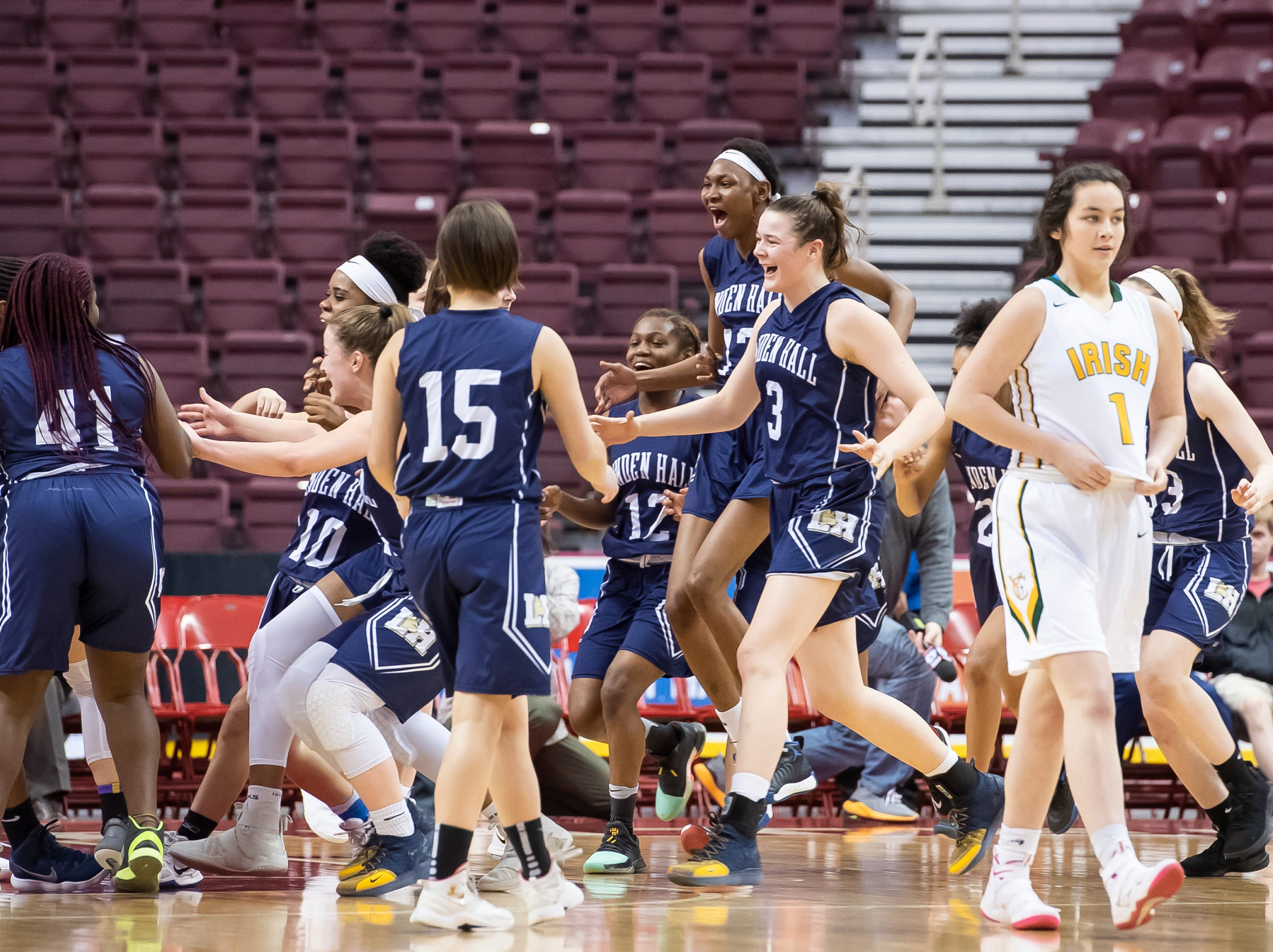 Linden Hall celebrates after defeating York Catholic in the District 3 2-A girls championship game against Linden Hall at the Giant Center in Hershey Tuesday, Feb. 26, 2019. The Fighting Irish fell 56-27.
