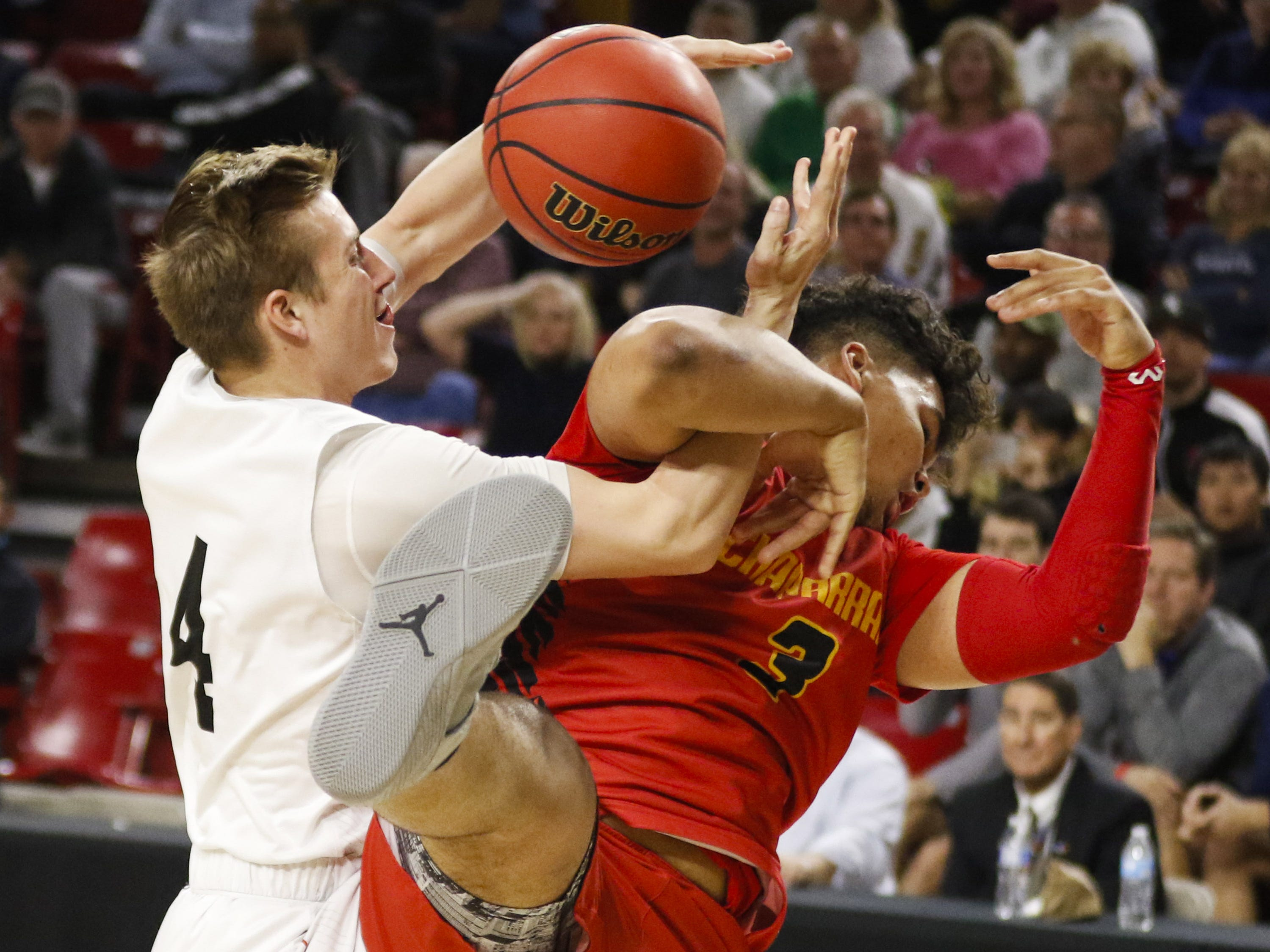 Pinnacle's Colby Howard (34) battles for the ball with Chaparral's Blaise Threatt (3) during the 6A Boys State Championship at Wells Fargo Arena in Tempe Tuesday, Feb 26, 2019.