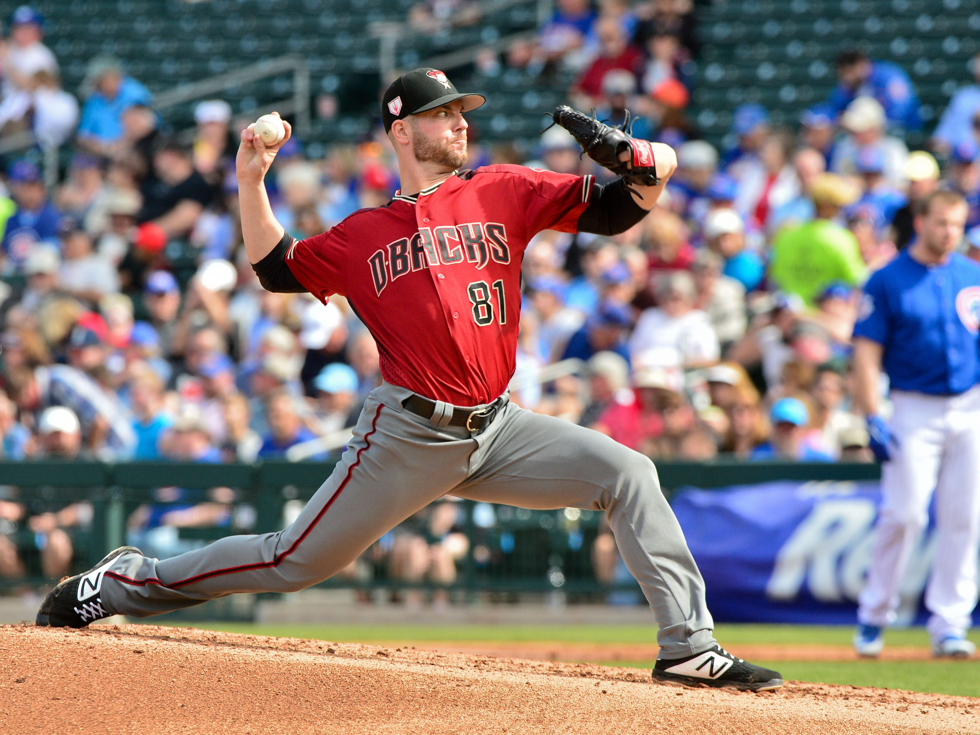 Feb 26, 2019: Arizona Diamondbacks relief pitcher Kevin Ginkel (81) throws during the first inning against the Chicago Cubs at Sloan Park.