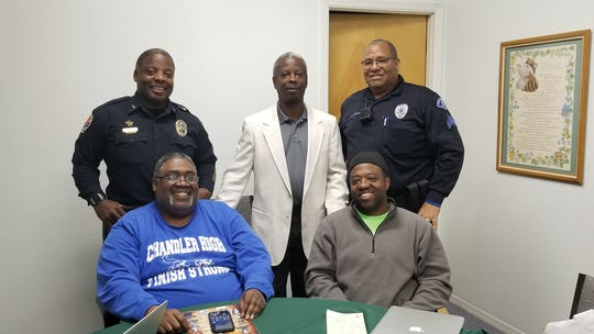 The mission of the Chandler Men of Action nonprofit organization is to mentor and provide positive role models for youth, particularly African Americans. Top row: Chandler Police Commander Edward Upshaw, Stephen A. Carson and Officer David Woodard. Bottom row: Victor Hardy and Earnest Robinson.