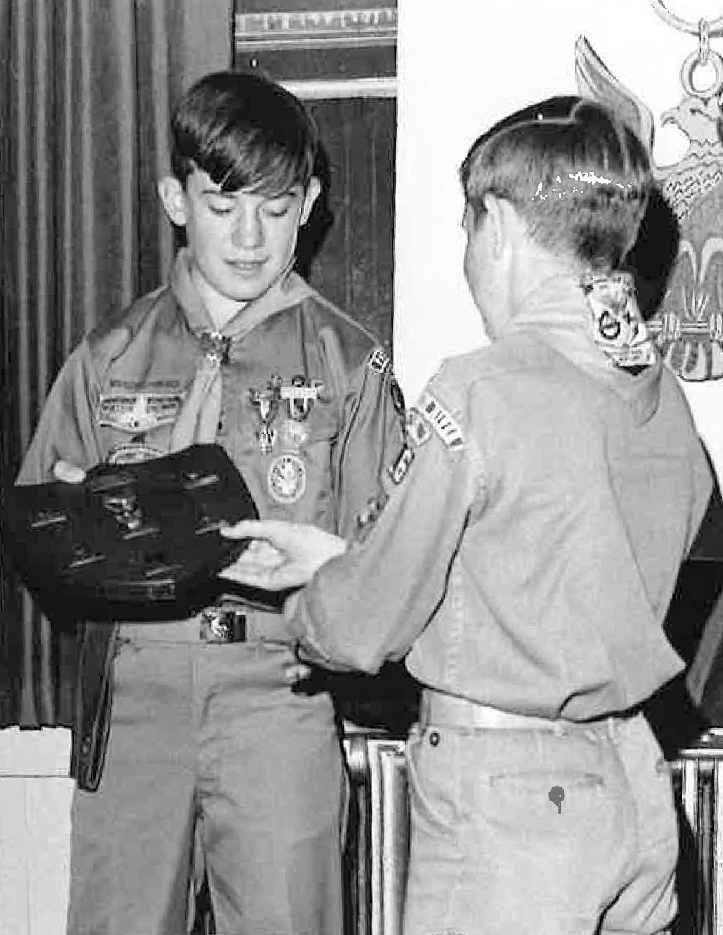 Michael Crow (left) receives his Eagle Scout badge in Maryland in 1969.