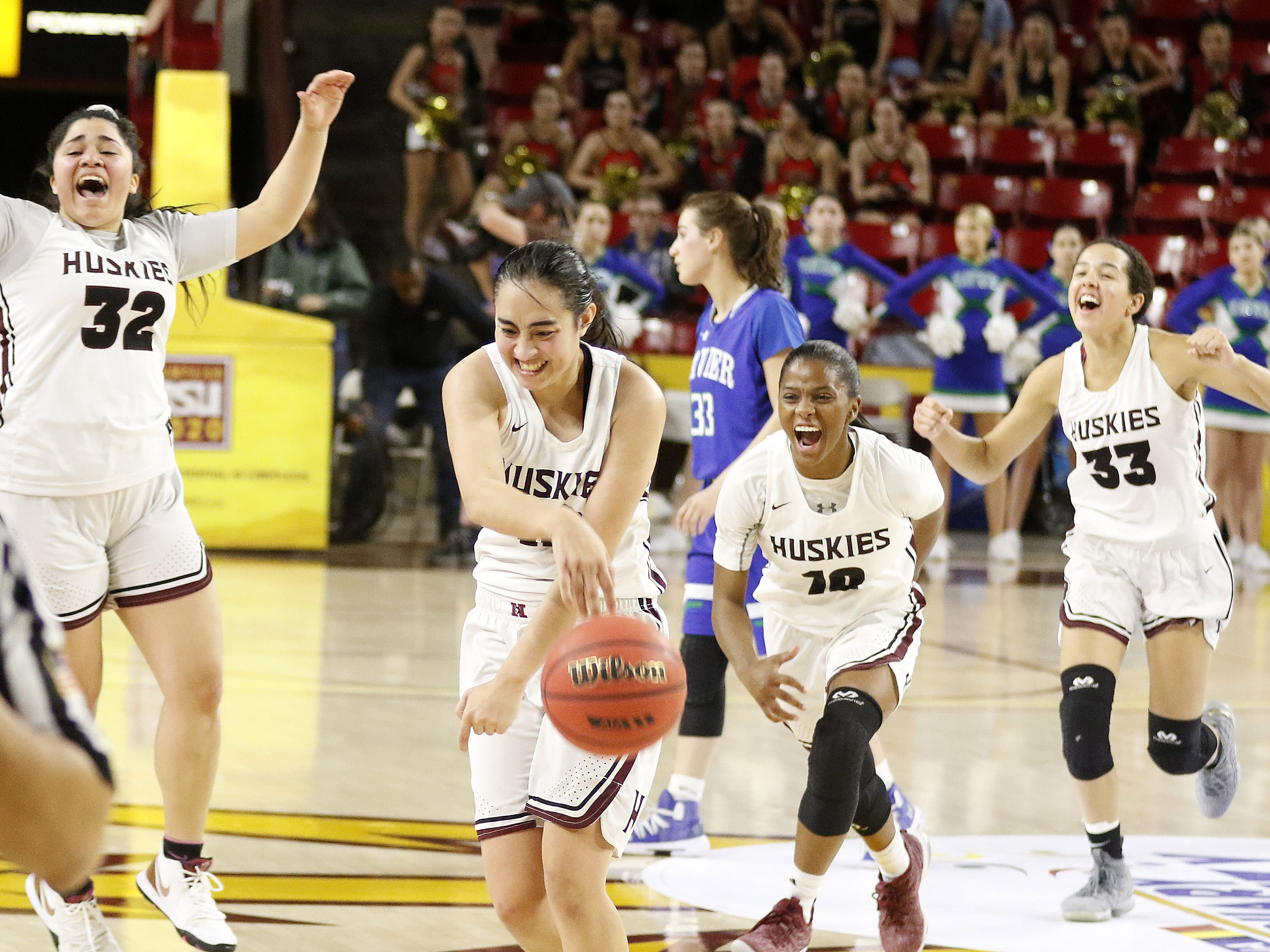 Hamilton players celebrate winning the 6A Girls State Championship over Xavier at Wells Fargo Arena in Tempe Tuesday, Feb 26, 2019.