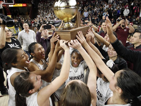 Hamilton players hoist the 6A Girls State Championship trophy over Xavier 48-33 at Wells Fargo Arena in Tempe Tuesday, Feb 26, 2019.