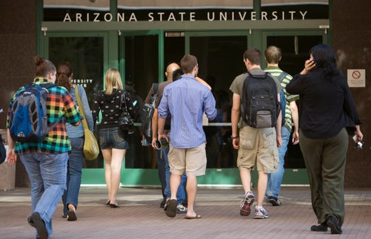 ASU students enter the University Center in downtown Phoenix on Nov. 9, 2009. The number of students taking classes at the downtown campus is up 41% from Fall 2008.