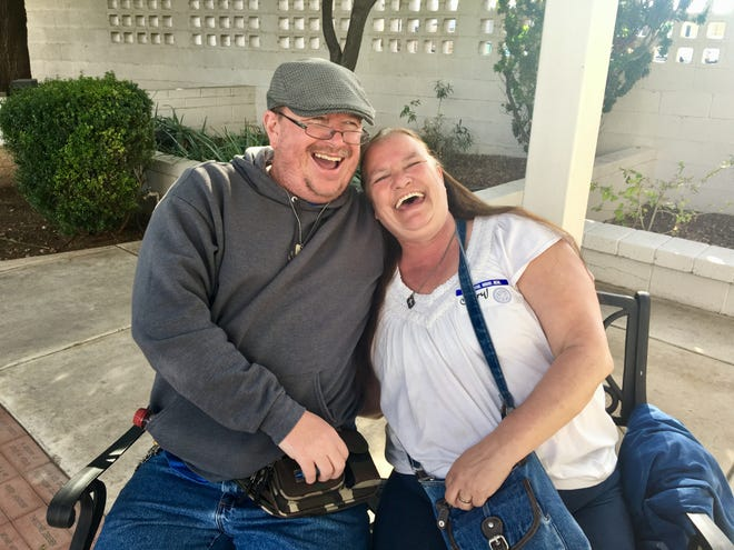 Jon Barker and Cheryl Pawloski came to the Society of St. Vincent de Paul's shelter separately. It wasn't the time or the kind of place where you would think you would find love. (Photo: Karina Bland/The Republic)