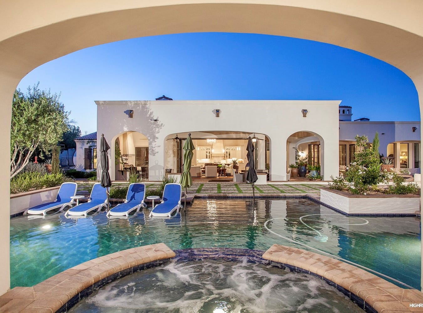 The Paradise Valley estate purchased by Thad and Maryellyn Miller, has a resort-style backyard that includes a gazebo with a swim-up bar.