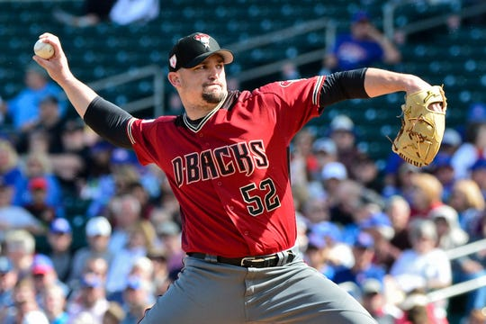 Feb 26, 2019: Arizona Diamondbacks starting pitcher Zack Godley (52) throws during the first inning against the Chicago Cubs at Sloan Park.