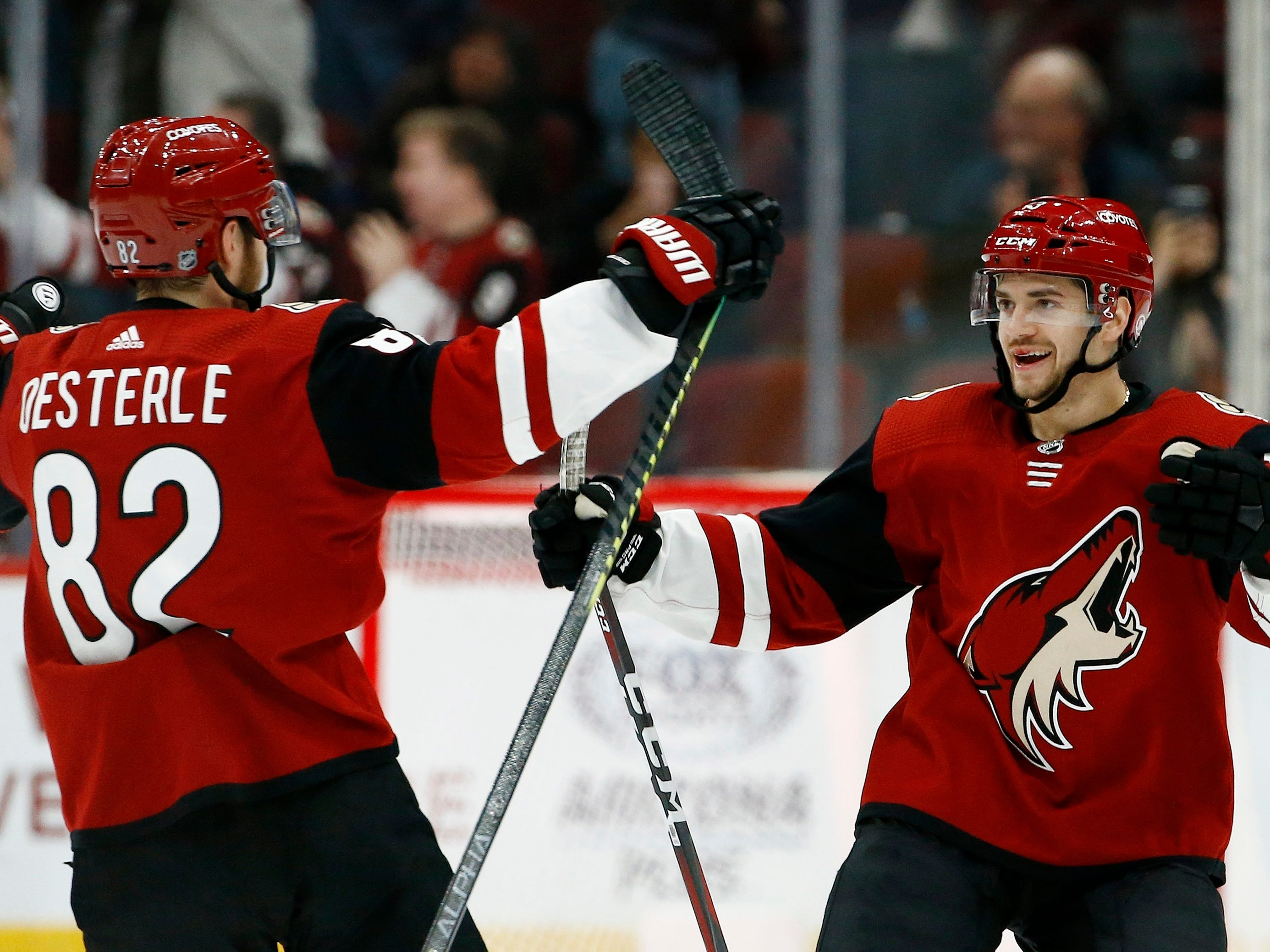 Arizona Coyotes center Vinnie Hinostroza, right, celebrates his goal against the Florida Panthers with Coyotes defenseman Jordan Oesterle (82) during the shootout in an NHL hockey game Tuesday, Feb. 26, 2019, in Glendale, Ariz. The Coyotes won 4-3.