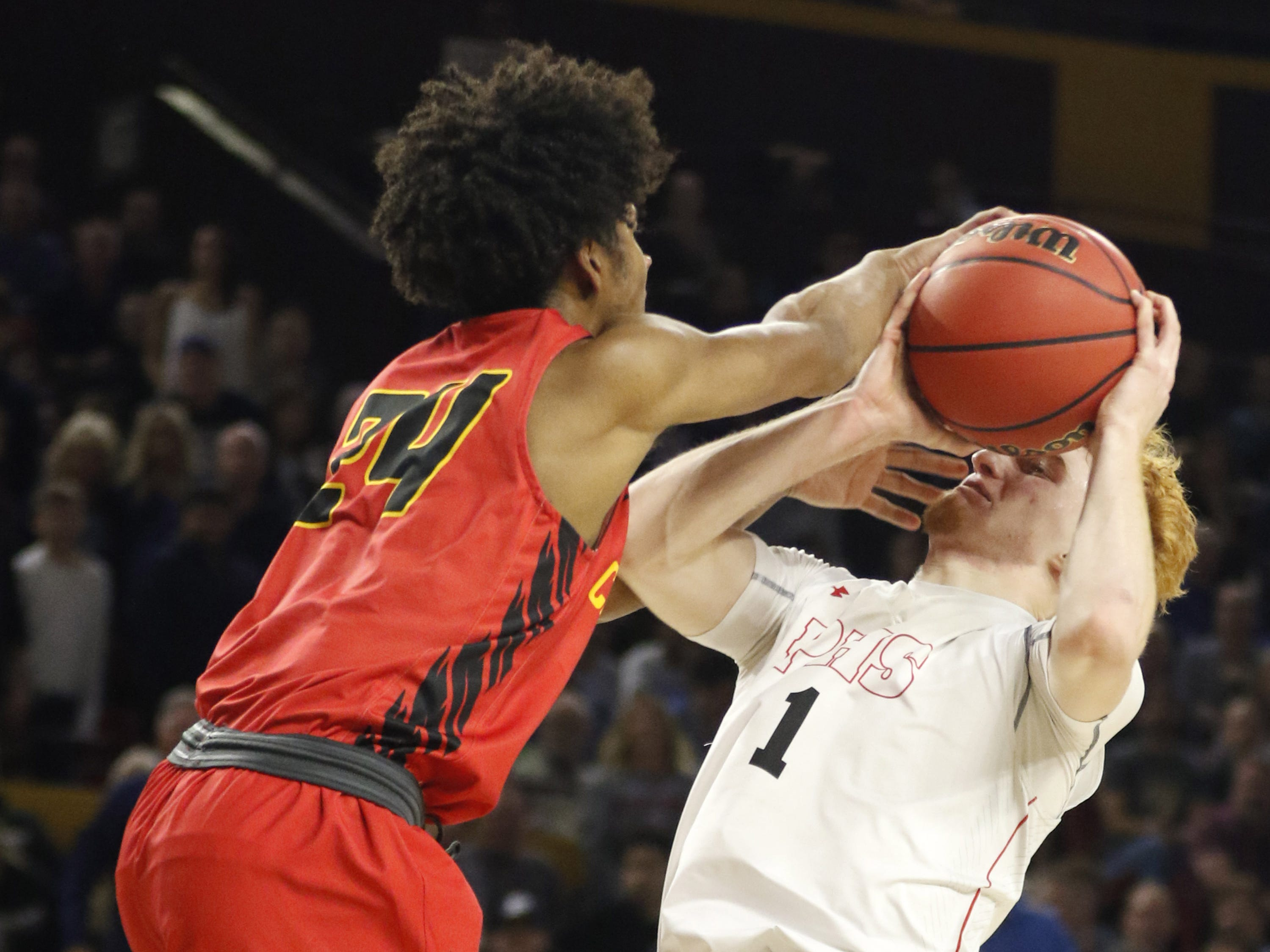 Chaparral Jordan Josephs (24) ties up Pinnacle's Nico Mannion (1) during the 6A Boys State Championship at Wells Fargo Arena in Tempe Tuesday, Feb 26, 2019.