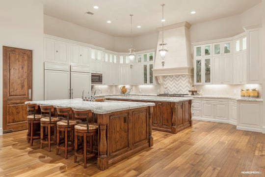 The 6,573-square foot Paradise Valley house, sold by Alasdair Stephen Cain, features a kitchen with double islands and granite countertops.