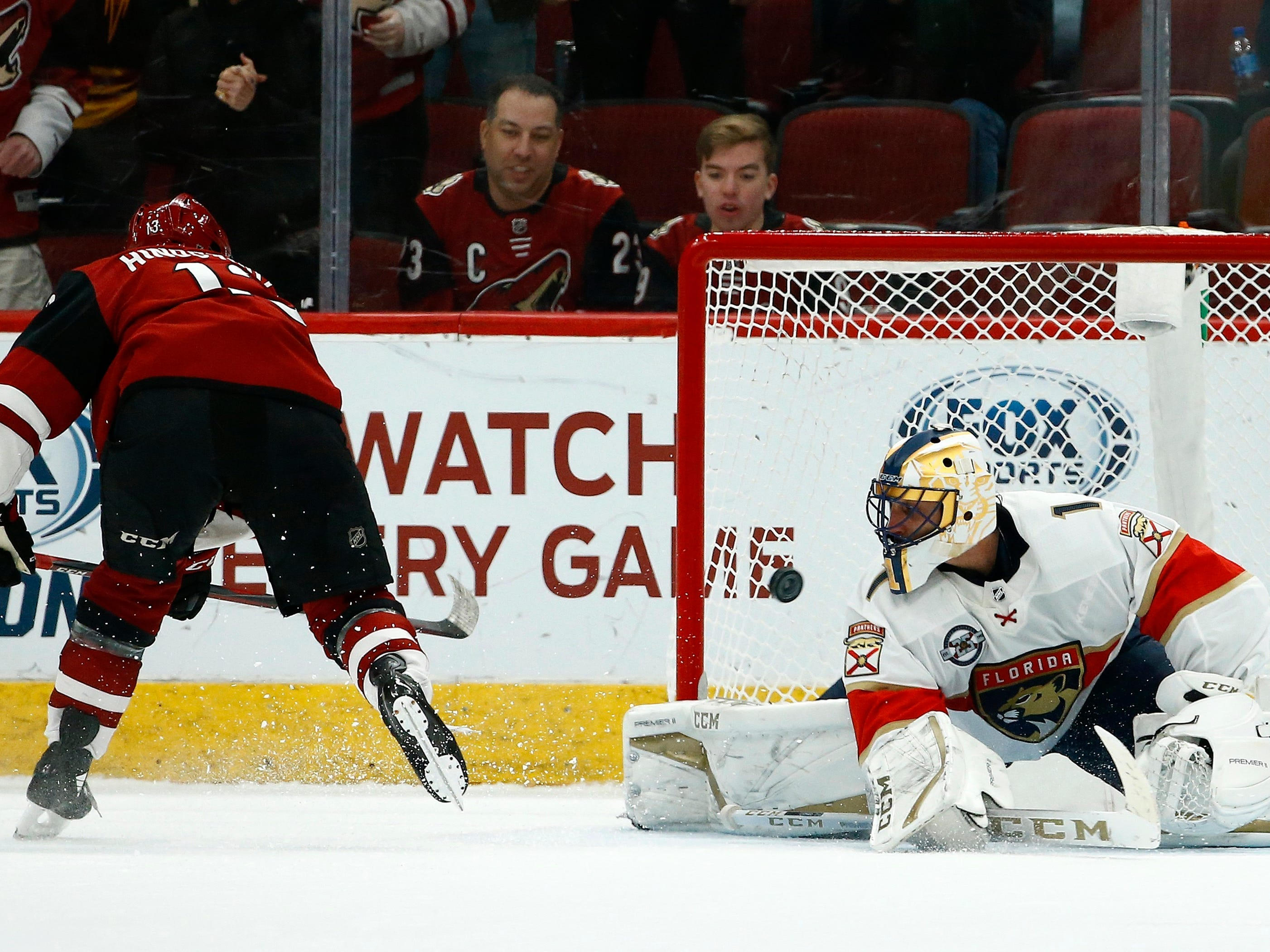 Arizona Coyotes center Vinnie Hinostroza, left, scores against Florida Panthers goaltender Roberto Luongo during the shootout of an NHL hockey game Tuesday, Feb. 26, 2019, in Glendale, Ariz. The Coyotes won 4-3.