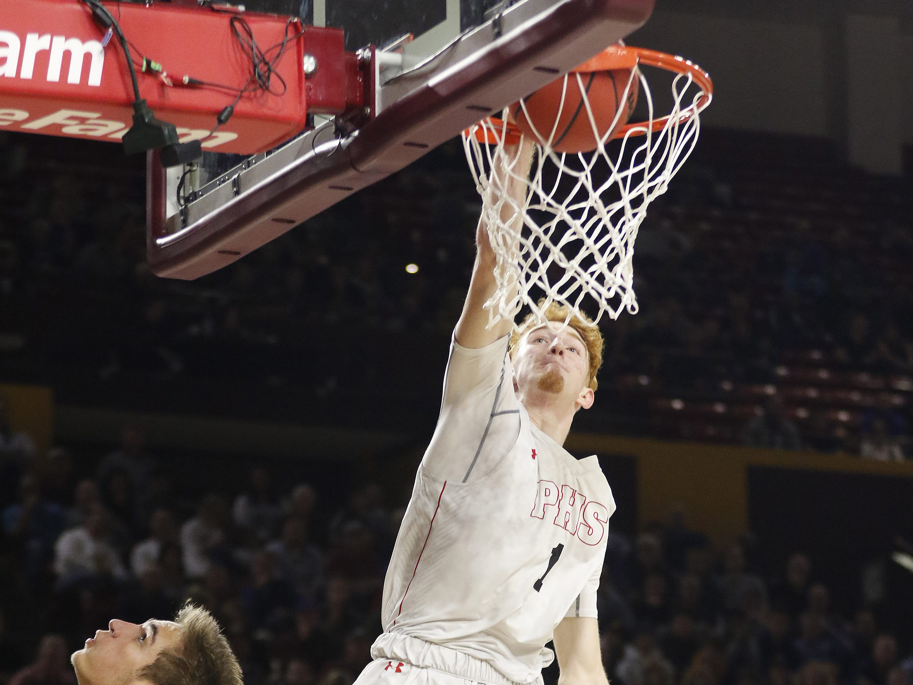 Pinnacle's Nico Mannion (1) slams one home against Chaparral during the 6A Boys State Championship at Wells Fargo Arena in Tempe Tuesday, Feb 26, 2019.
