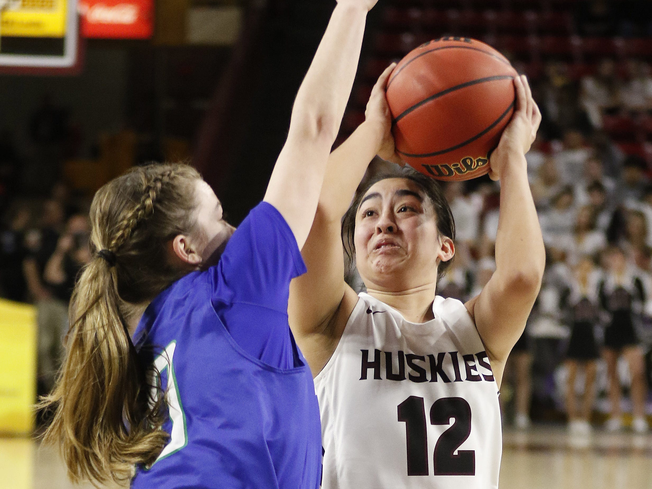 Hamilton's Samara Curry (33) puts up a shot against Xaiver during the 6A Girls State Championship at Wells Fargo Arena in Tempe Tuesday, Feb 26, 2019.