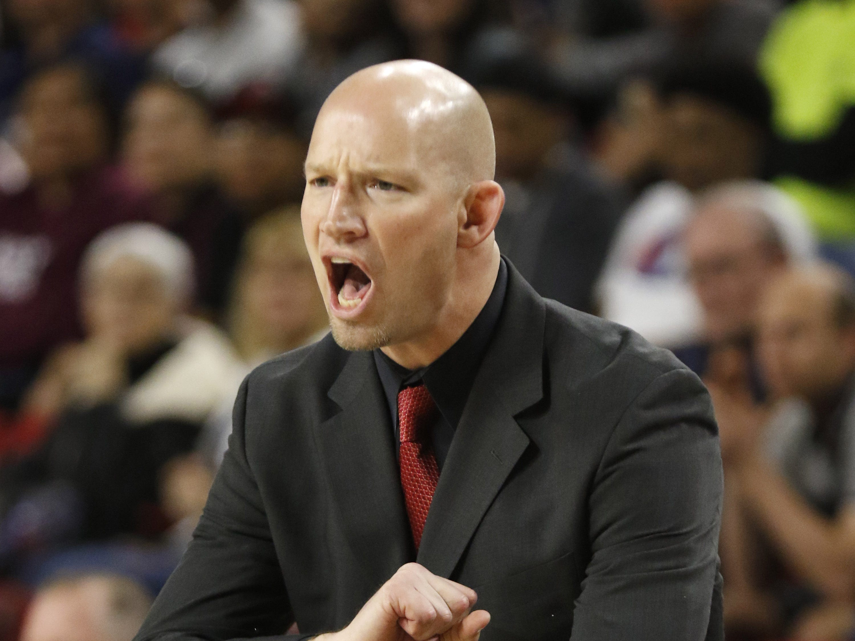 Chaparral head coach Dan PetersonÊhollers out to his team against Pinnacle during the 6A Boys State Championship at Wells Fargo Arena in Tempe Tuesday, Feb 26, 2019.
