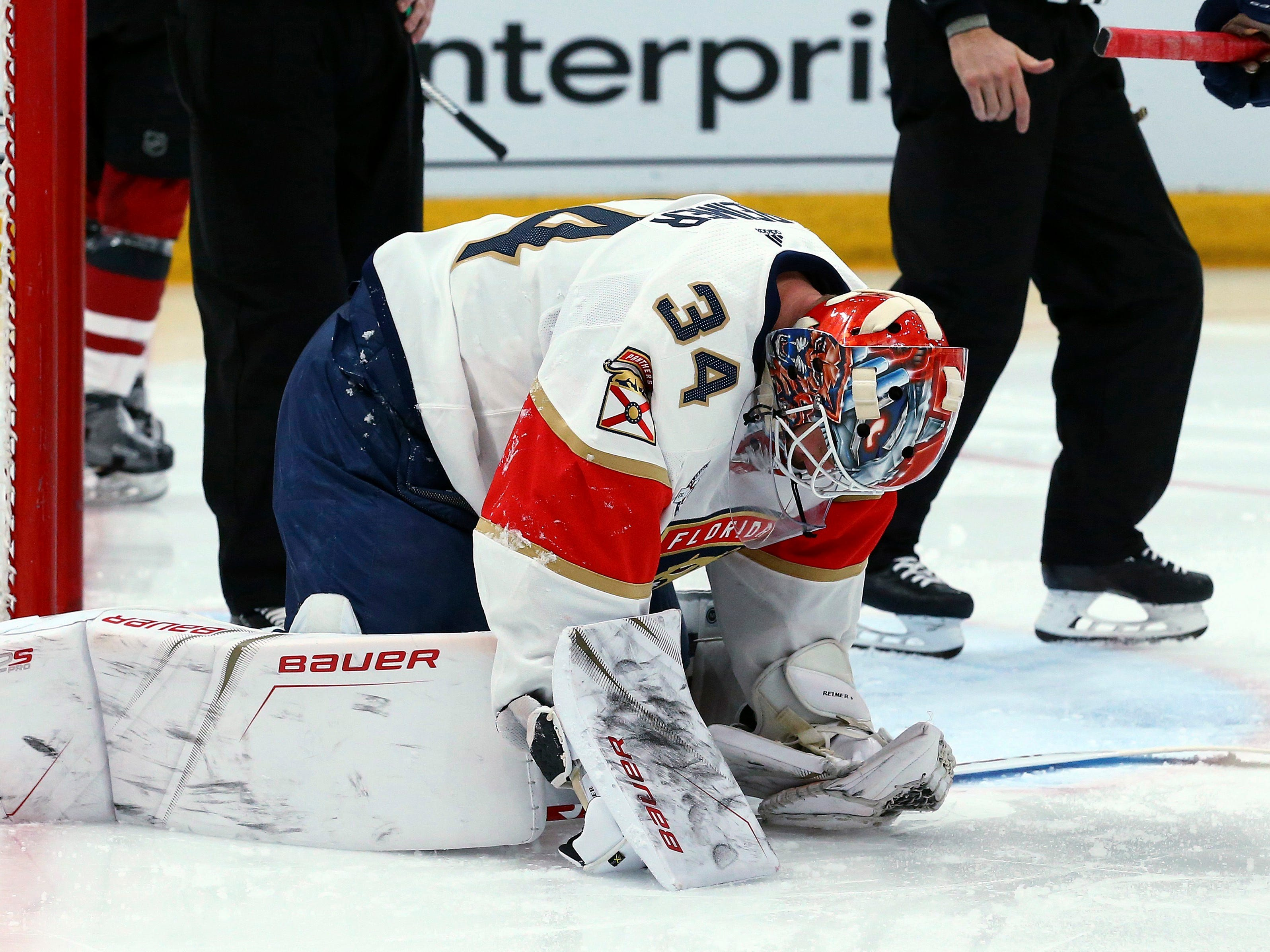 An injured Florida Panthers goaltender James Reimer pauses on the ice during the second period of the team's NHL hockey game against the Arizona Coyotes on Tuesday, Feb. 26, 2019, in Glendale, Ariz. Reimer left the game.