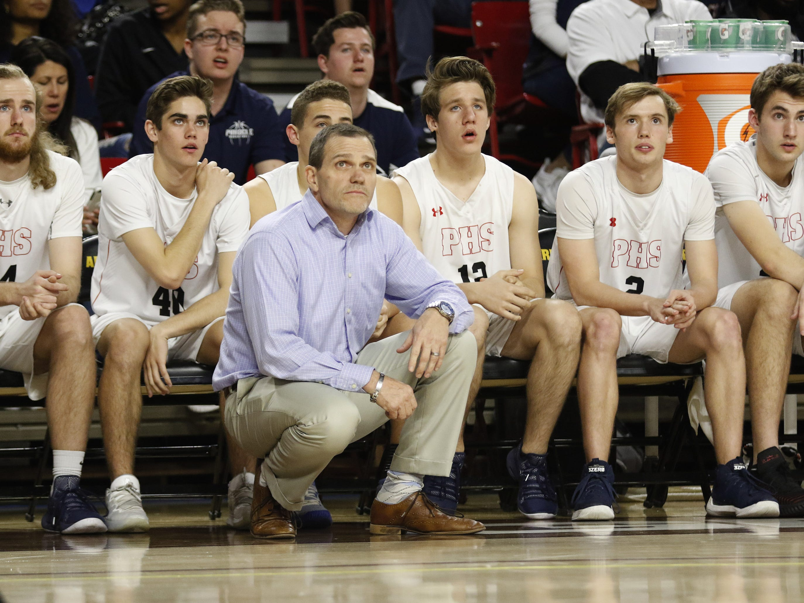 Pinnacle head coach Charles Wilde watches his team late in the game against Chaparral during the 6A Boys State Championship at Wells Fargo Arena in Tempe Tuesday, Feb 26, 2019.