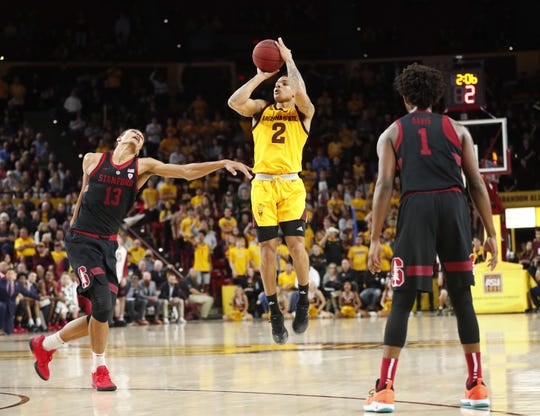 Rob Edwards puts up a three-pointer over Stanford forward Oscar da Silva during a game at Wells Fargo Arena.