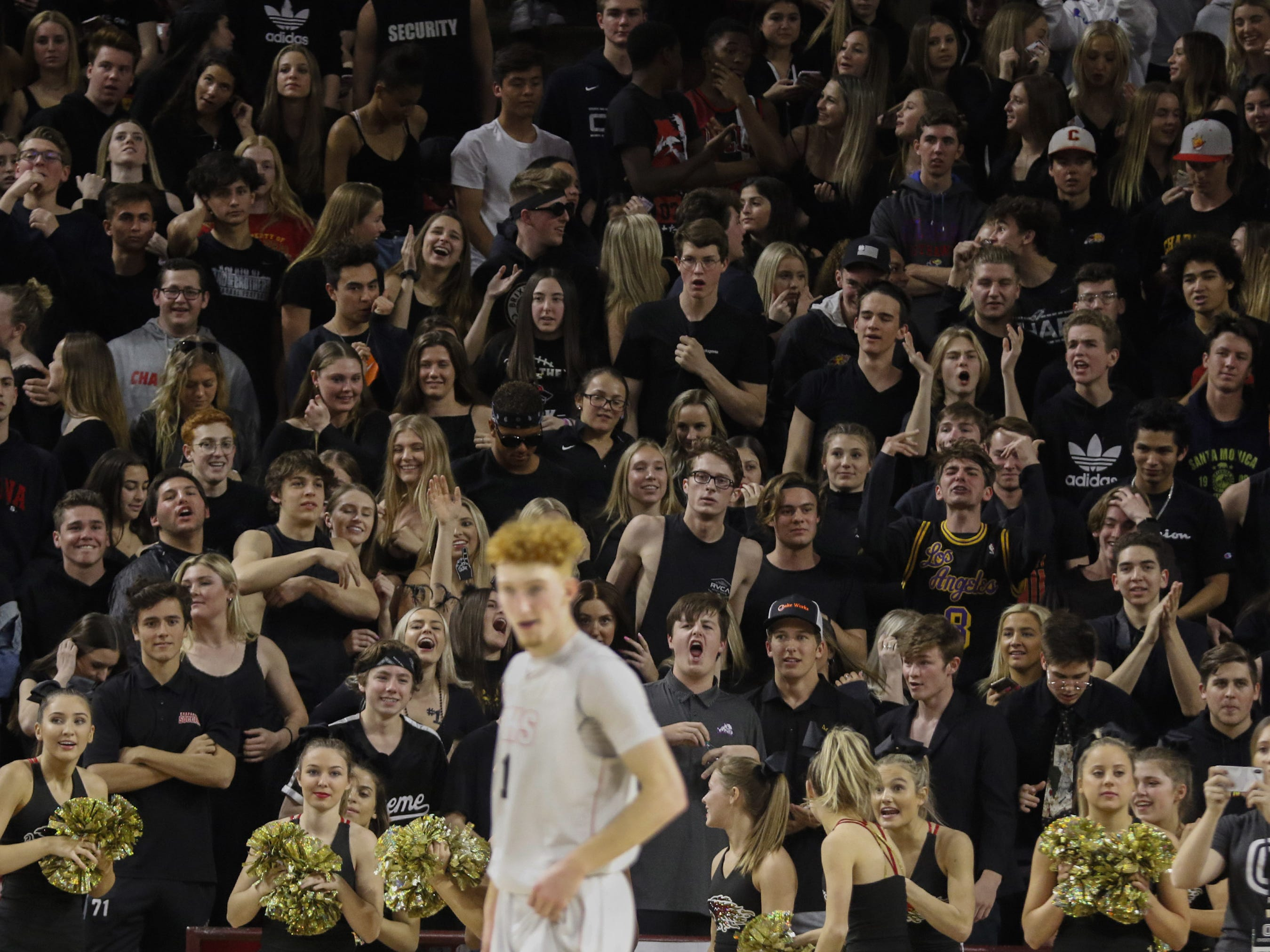Chaparral's student body gives Pinnacle's Nico Mannion (1) a hard time during the 6A Boys State Championship at Wells Fargo Arena in Tempe Tuesday, Feb 26, 2019.