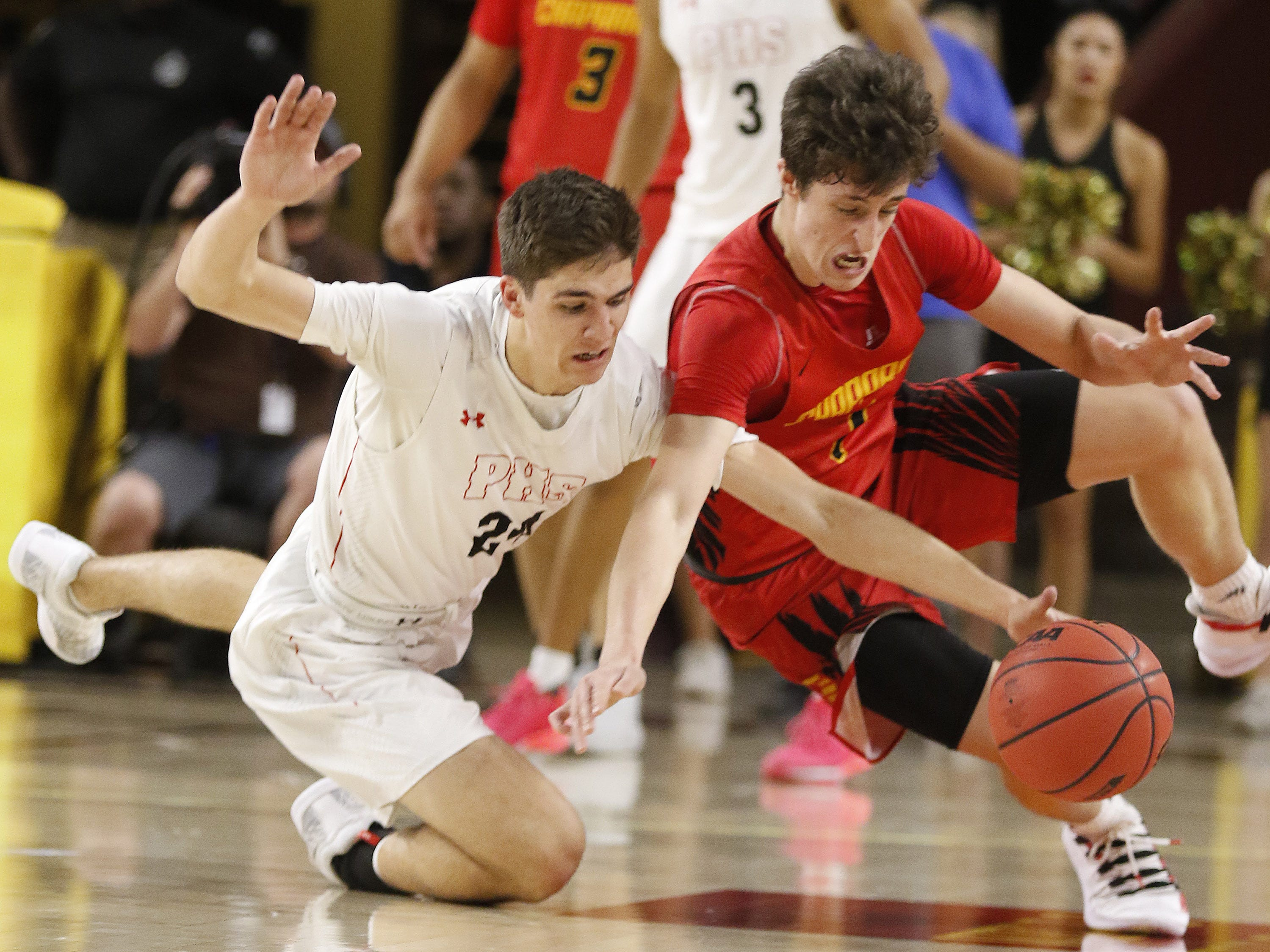 Pinnacle's Trent Brown (24) battles for a loose ball with Chaparral's Alem Huseinovic (1) during the 6A Boys State Championship at Wells Fargo Arena in Tempe Tuesday, Feb 26, 2019.